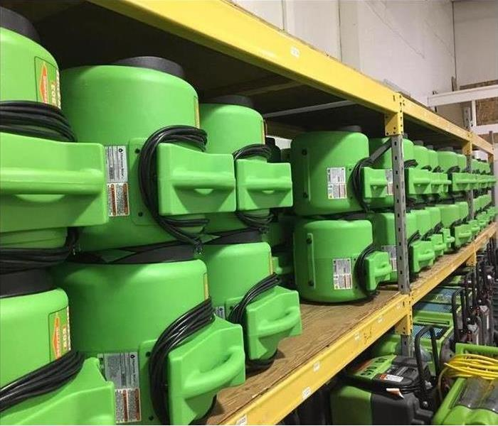 Our new green equipment on the shelves in the warehouse