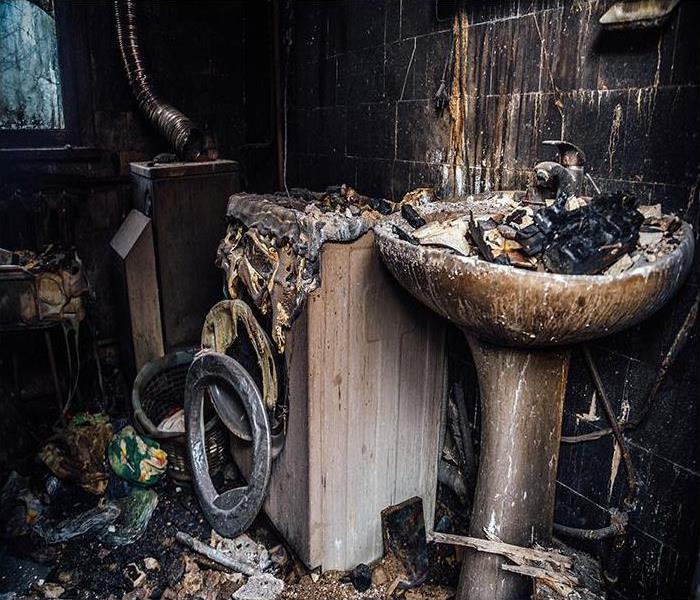 Burnt house interior covered in soot after a fire